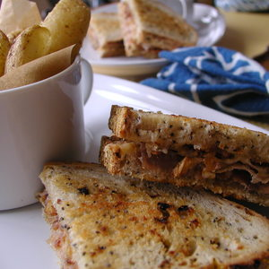 """""""Sweet Heat"""" Grilled Prosciutto and Smoked Gouda Sandwich (with spicy plum chutney and crispy onions)"""